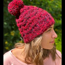 Handmade loom knitted red multi sparkle coloured hat