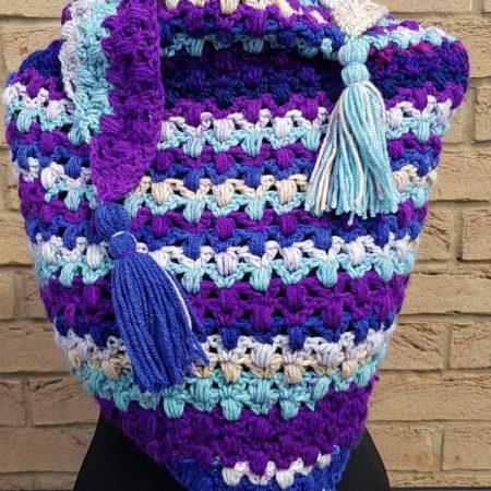 Shawl/scarf/wrap crocheted. Purple multi with tassels. Textured.
