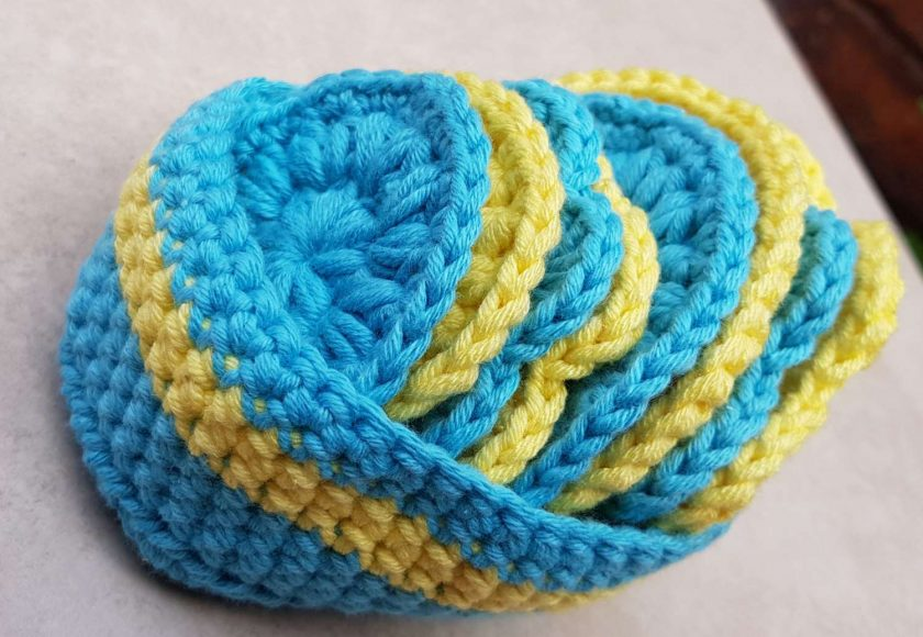 Crocheted face scrubbies with basket 1