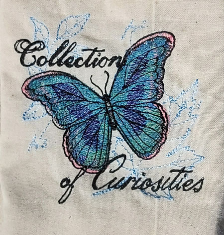 Curious Butterfly embroidered tote bag 1