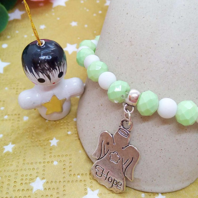 Christmas Stretch Bracelet with a Silver Christmas Angel Charm with Pale Green and White Faceted Beads 3