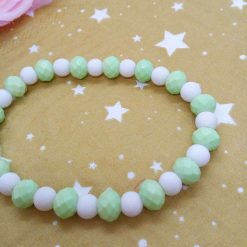 Christmas Stretch Bracelet with a Silver Christmas Angel Charm with Pale Green and White Faceted Beads 10
