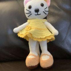 Happy cat in yellow dress