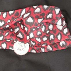 Luxurious pure silk face mask.  Red, white and black pattern.  Triple layer