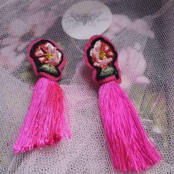 Bright pink flower embroidered tassel earrings.