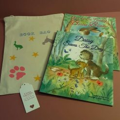 Children's hand printed cotton drawstring book pouch containing 2 story books.