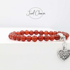 Handmade red Carnelian gemstone bracelet shown with a Heart charm