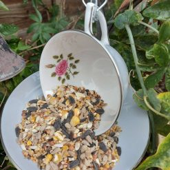 Vintage grey teacup bird feeder