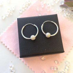 Hoop earrings with stardust bead