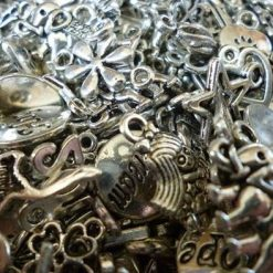 100 mixed silver tone charms