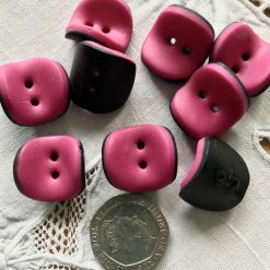 Curved pink and black buttons