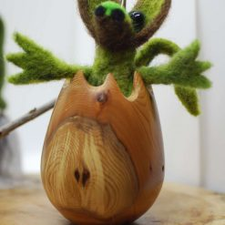 Needle felted dragon hatching from turned wooden egg