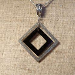 Black and white resin pendant
