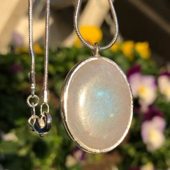 Unique handmade pearlescent pendant, in a oval setting with solid silver chain