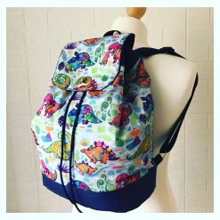 Children's Dinosaur Rucksack Backpack with Blue Faux Leather and Waterproof Dinosaur Fabric