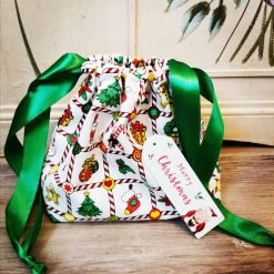 Small Christmas gift bag with wooden tag