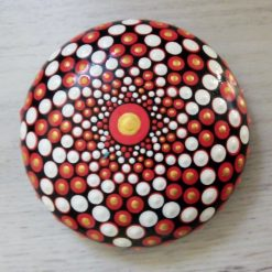 Red and white hand cast mandala stone