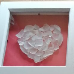 Sea glass heart on red