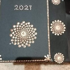 Gold dot painted black agenda