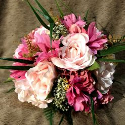 Pink bridal bouquet and matching groom's buttonhole