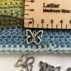 9 x hollow butterfly Tibetan silver charms 2cm