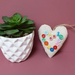 Fabric heart home decor with heart embellishment.