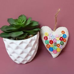 Fabric heart home decor with  button embellishment.