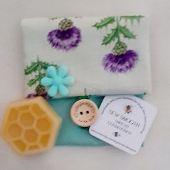 Sew Smooth beeswax thread conditioner in a Scottish thistle design pouch