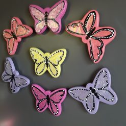 Ceramic hand painted butterfly fridge magnets in pink