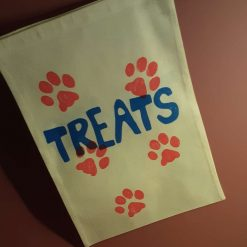 Handprinted drawstring dog treat bag.
