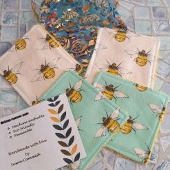 A set of 4 reuseable makeup remover pads/ facial cleansing wipes.  Beautiful bees.