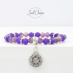 Handmade Amethyst gemstone bracelet shown with a sunflower charm