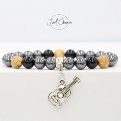 Handmade Hematite, Onyx and Picture Jasper gemstone bracelet shown with a guitar charm