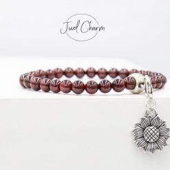 Handmade Garnet gemstone bracelet shown with a Sunflower charm