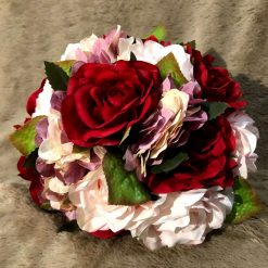 Romantic bridal bouquet and matching groom's buttonhole