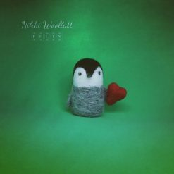 Penguin Chick Carrying a Heart needle felted sculpture