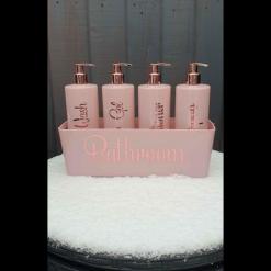 Pink Hinch style pump bottles bathroom set.