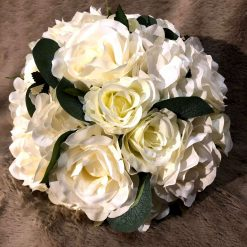 White bridal bouquet and matching groom's buttonhole