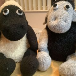 Hand knitted fluffy sheep doorstops