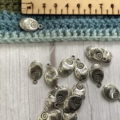 9 x crossed snake Tibetan silver charm - 3cm
