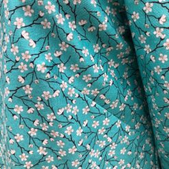 Ladies teal tunic top with blossom print Size 12-14 2
