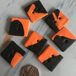Large square black & and orange buttons