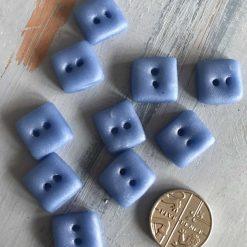 Light blue little square buttons