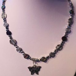 Necklace with metallic beads and butterfly pendant