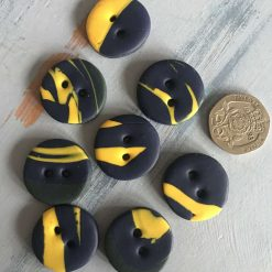 Navy and yellow round buttons