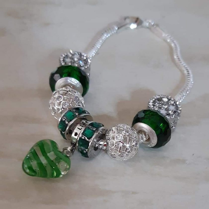 A stunning sterling silver bracelet featuring a heart charm.