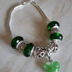A stunning sterling silver bracelet featuring a heart charm. 3