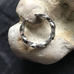 """""""Twisted Reality"""" open ended spiral heart ring in 925 silver."""