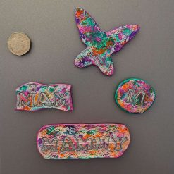 fridge magnet made with air dry clay and painted multicoloured