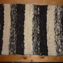 Jacobs fleece peg loom woven rug with tassels